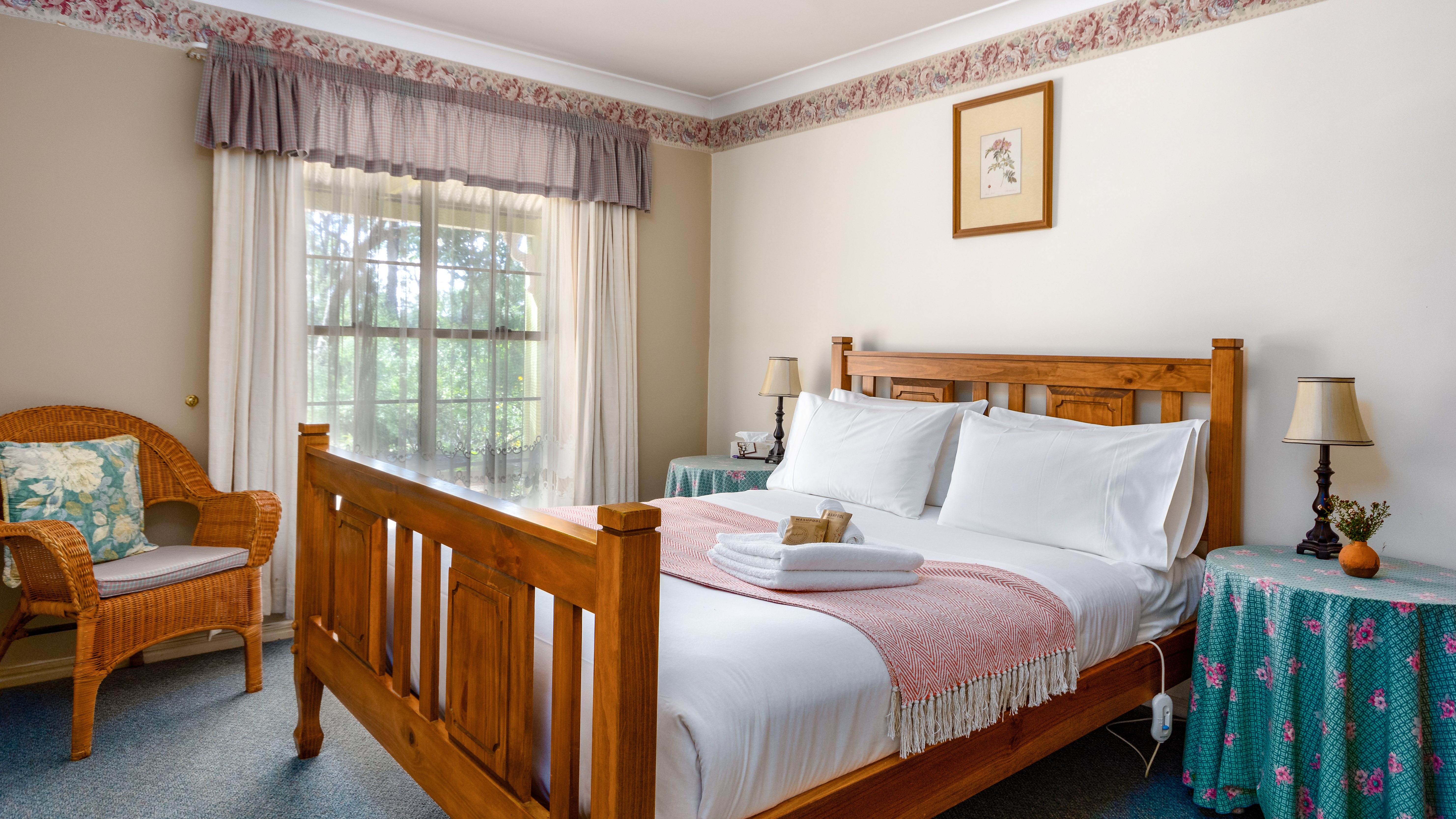 Comfortable queen sized bed in each of our two bedroom cottages